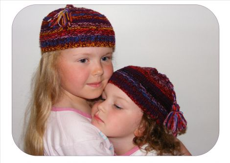 Eve and Faith modelling Sheila's hats