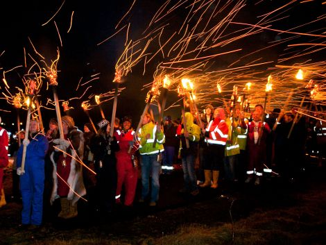 Sparks fly during the procession
