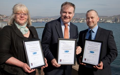 Jennifer Mouat of the SSMO, Richard Lochhead and Martin Robinson show off the MSC certificates for king scallops, brown and velvet crabs. Pic. Billy Fox