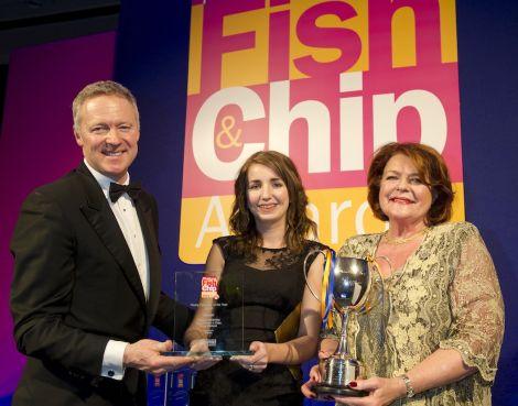 Fish frying princess Carlyn Kearney accepts her award from comedian Rory Bremner alongside award sponsor Briar Wilkinson. Pic. Seafish