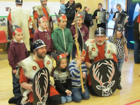 Jarl squad members John Manson and Scott Hatrick with South Nesting primary school bairns. Photo. Jennie Bradley