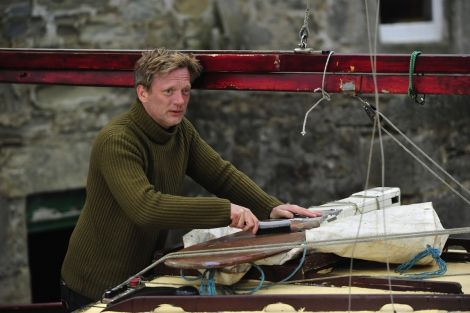 Douglas Henshall gives his wee boat a scrape as he figures out who killed who in 'Shetland'. Photo BBC