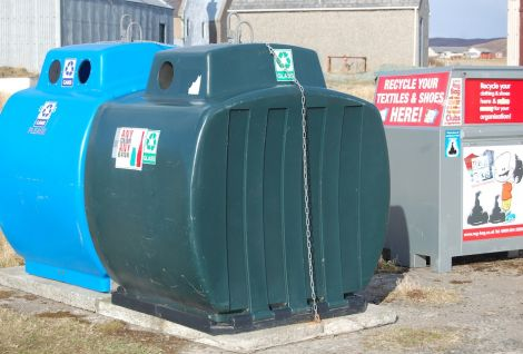 New council glass and metal recycling bins at Hillswick, with an extra bin from NCDC for clothes. Plastic and paper are too bulky for rural recycling in rural Shetland. Photo Shetland News