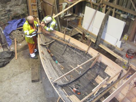 Local boat builders Jack Duncan and Robbie Tait restoring the Ann - Photo: Shetland Museum and Archives