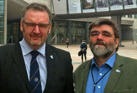 Flying the Shetland flag in Brussels are SIC political leader Gary Robinson (left) and Lerwick councillor Jonathan Wills - Photo: SIC
