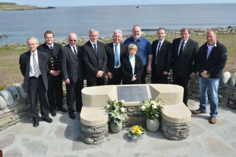 The Sumburgh Airport Memorial committee (from left to right): Allison Duncan, Aubrey Jamieson, Alan Sinclair, Nigal Flaws (chairman), Dave Ellis (treasurer), Pauline Nixon, Terry Williamson, Norman Sineath, Ronnie Leslie and Tom Jamieson. Also on the committee, but not on the photo, was Jim Livett - Photo: Malcolm Younger/Millgaet Media