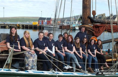 Ten of the 14 teenagers going on two exciting sailing trips this summer are (from left to right): Eve Maguire; Laura Hampton; Emma Cockerill; Valerie Robinson; Steven Anderson; Georgia Leask; Molly Brindley; Diana Inkster; Kate Tyler and Ailish Parham. With them are (back row): Sail Training Shetland chairman Peter Campbell, Swan skipper Richard Pattison and bosun Scott Sandison. Missing from the photo are: Orren Holt; Michaela Peterson; Heather Gray and Thomas Meadows.