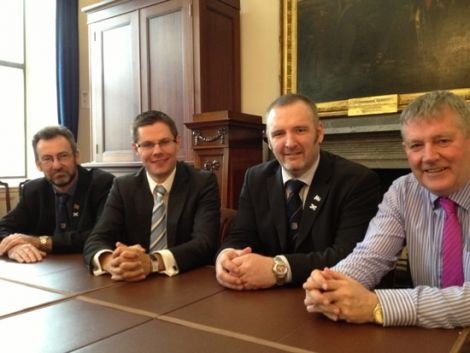 All hands together. Orkney Islands Council convener Steven Heddle, local government minister Derek Mackay, SIC leader Gary Robinson and Western Isles Council leader Angus Campbell after Thursday's meeting. Photo Scottish government