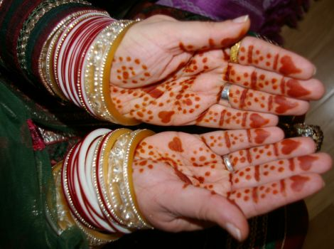 Rama's henna-painted hands from the Mendi, the pampering of the bride