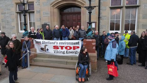 Anti-Viking Energy campaigners protest outside Lerwick Town Hall in December 2010 before councillors decided not to object to the wind farm. Photo ShetNews
