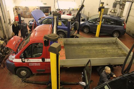 Service Advisor Eve Eunson is updated on a variety of jobs in the busy workshop.