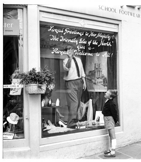 Attie Coutts signwriting in his shop window for the occasion of the Royal Visit in 1960 by Queen Elizabeth. Photo: Dennis Coutts