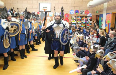 Brae Guizer Jarl Peter Peterson wows the bairns at Lunnasting primary at the start of a long and busy day and night. Photo Kevin Osborn