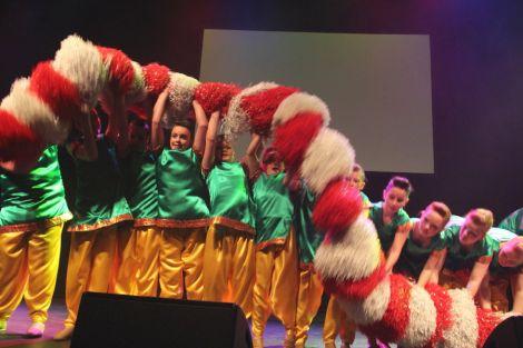 The baton twirlers pom pom group.