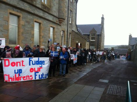 Angry protesters encircling Lerwick Town Hall last November when the council voted to consult on Don Ledingham's S1-2 suggestion. Photo Shetnews