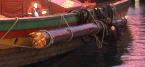 The broken mast tied to the longship - Photo: Ian Leask
