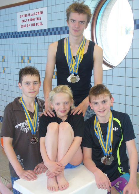 Four years ago with her fellow Delting Dolphins, Felix Gifford (standing), Iain Leach (left) and Logan Jamieson. Photo Lorraine Gifford