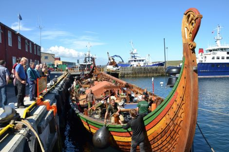 The crew of the Draken Harald enjoyed bright sunshine as they tidied up the longship on Monday. Photo: Shetnews/Neil Riddell