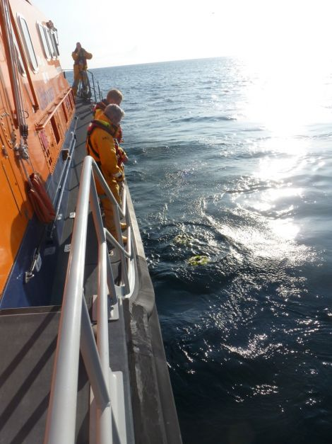 A poignant scene as wreaths are laid at sea in the area where the helicopter ditched 12 months ago. Photo courtesy of RNLI