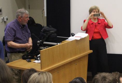Nicola Sturgeon takes a photo of the audience before addressing them on Wednesday night, while BBC engineer John Waters packs up his equipment after the debate.