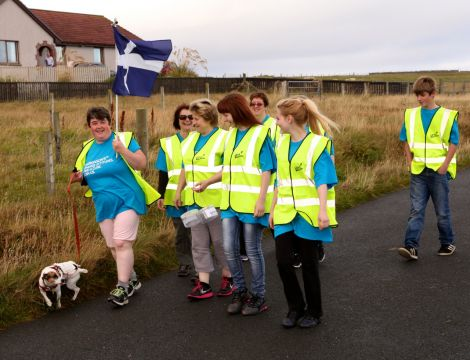 Liz Peterson out on the walk, along with her Jack Russell and friends, on Sunday. Photo: Barry Broadbent