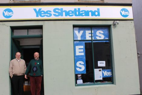 Brian Nugent (right) and Richard Boston outside their crowd-funded Yes Shetland shop. Photo Shenews