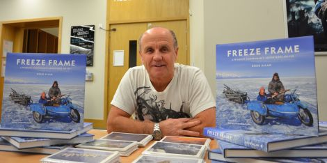 Wildlife photographer Doug Allan at Mareel with copies of his new book Freeze Frame. Photo Shetland News