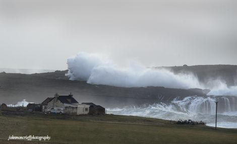 Waves towering over a croft building at Eshaness - Photo: John Moncrieff