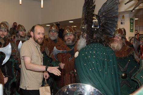 Shetland Museum curator Ian Tait greets the Jarl's Squad on Tuesday afternoon. Photo: Shetnews