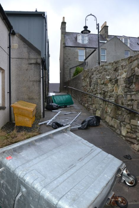 Wheelie bins on their side in Lerwick's Pitt Lane. Photo: Shetnews
