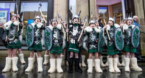 Lerwick Up Helly Aa's 2015 junior Guizer Jarl Lewis Harkness and his squad on Commercial Street. Photo: Craig Sim
