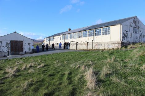 The former school canteen used as a galley shed (left) and the main old school building in need of major repairs. Photo Shetnews.