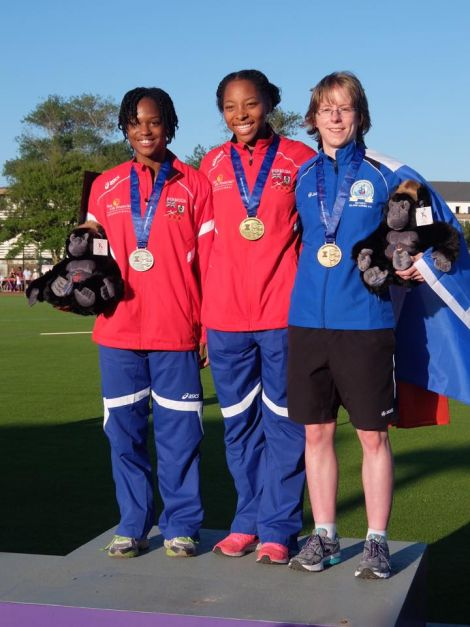 Unst runner Faye Cox with the gold and silver medallists Taahira Butterfield and Natasha Trott, both from Bermuda - Photo: SIGA