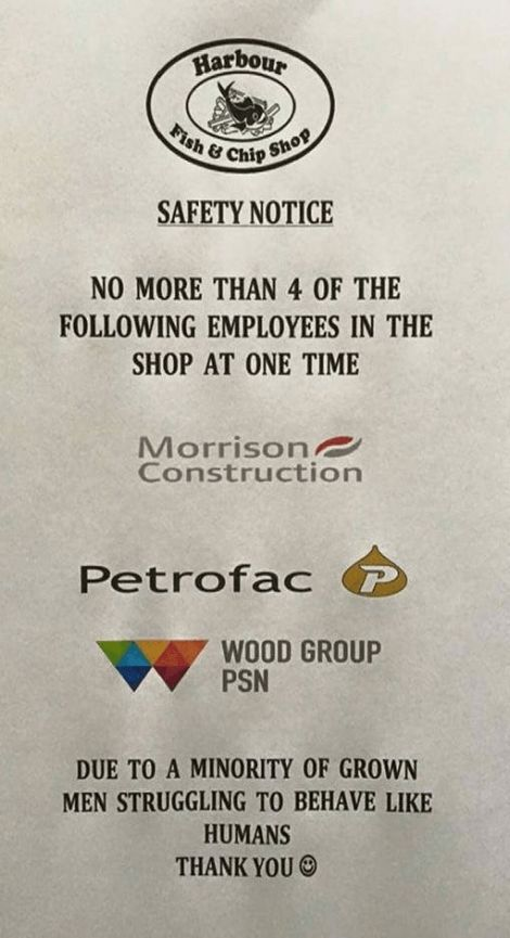 The original sign restricting the number of construction workers allowed in the shop.