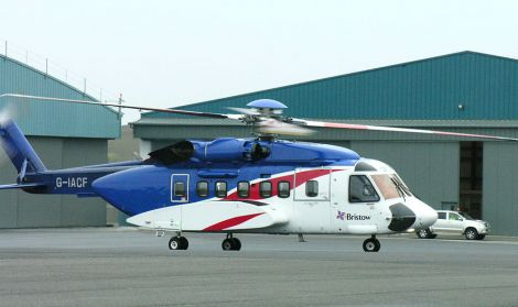 A Bristows helicopter at Scatsta airport, where job losses are on the cards over the next few months. Photo Shetnews