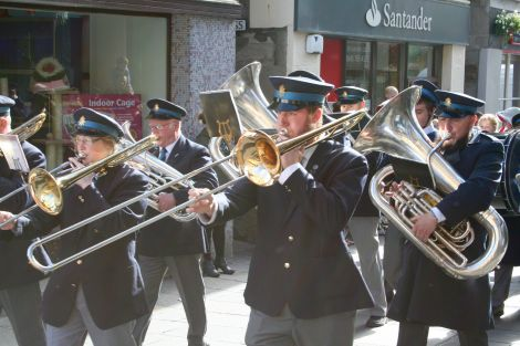 The Lerwick Brass Band on a sun-kissed Saturday in Lerwick. Photo: Chris Cope/ShetNews