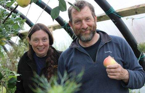 Enjoying some Shetland grown apples: Sue Hinton and Tom Jenkinson in one of their two poly clubs - Photos: Hans J Marter/ShetNews