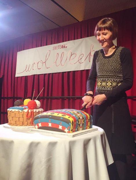 This year's Shetland Wool Week patron Donna Smith cutting the cake - Photo: Shetland Wool week