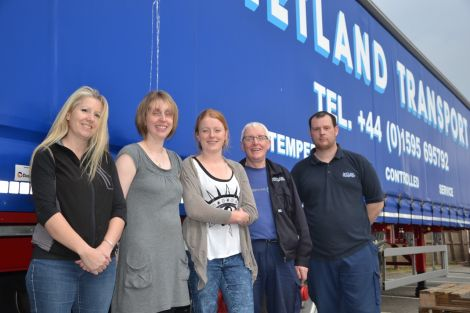 Kaila McCulloch, Emma Harmer and Rona Arthur from the Shetland Solidarity with Refugees group, along with Shetland Transport's Hamish Balfour and Raymond Stewart, after packing up the final pallet ahead of shipping donations to Inverness six weeks ago. Photo: Shetnews/Neil Riddell
