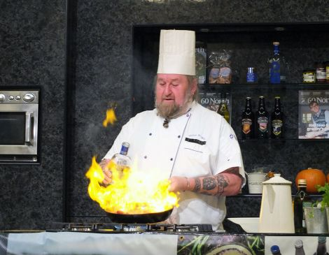 Chef Glynn Wright, who is about to open a steakhouse in Lerwick, fanning the flames. Photo: Elizabeth Atia