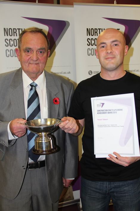 Trevor Tulloch (right) received his awards from past president of the Scottish Decorators Federation Eric Rasmussen.