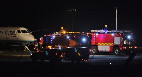 Emergency services greet the Loganair aircraft on the runway at Sumburgh on Wednesday night. Photo: Ronnie Robertson