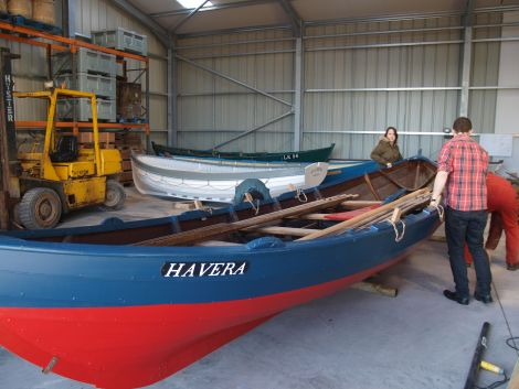 Some of the boats being moved into place at the new store and workshop.