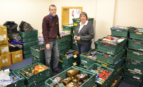 David Grieve and Angela Nunn of the Salvation Army's Lerwick branch with goods donated for food parcels. Photo: Shetnews/Neil Riddell