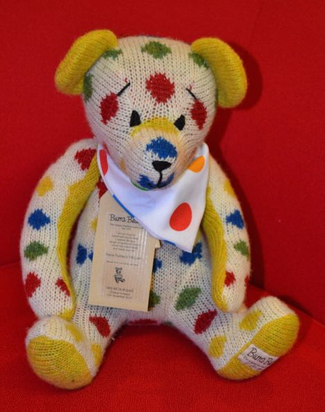 A Burra Bear knitted by Wendy Inkster in Children in Need colours for last year's auction. Photo BBC Radio Shetland