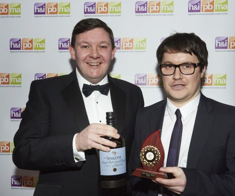Shetland News reporter Neil Riddell (right) collecting one of two awards from Keith Miller of the main sponsor of the media awards event, drinks company Diageo - Photo: Lucid PR