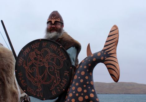 Guider Jarl Thorir Hund at the tail end of his galley Ain Urrida on a wet and windy Friday afternoon in Hillswick.