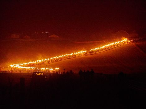 460 torch wielding guiders follow the SMUHA galley down to the Peerie Spiggie beach on Friday night for the burning. Photo Chris Brown