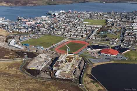 A new Lerwick landmark is growing from the rocks of Staney Hill - the new Anderson High School with the Halls of Residence on the left - Photo: John Coutts