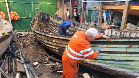 Robbie Tait and Jack Duncan working on the restoration. Photo Shetland Museum and Archives